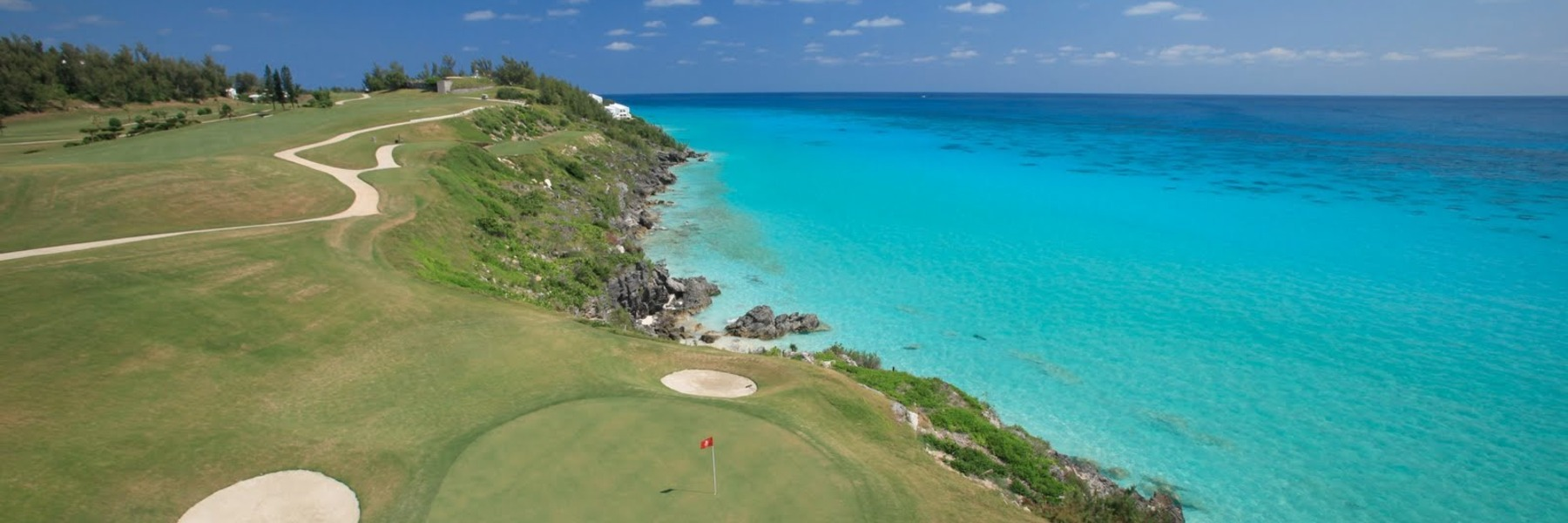 Golf Vacation Package - Colors of Bermuda UNLIMITED GOLF Stay & Play at Coco Reef Beach Resort for $197 per day!